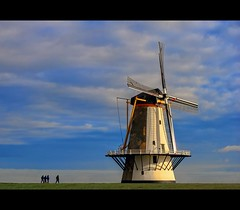 The Windmill (Wim Koopman) Tags: sky people holland mill netherlands windmill dutch clouds canon walking photography photo view stock wide nederland powershot dyke dike stockphoto stockphotography wpk s95