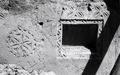 Traditional detail on what is left of a mud-brick wall, built in the traditional Nejd style, Deerah, Riyadh, March 2013 (SplittingImages) Tags: blackandwhite black art blancoynegro film blanco monochrome analog 35mm 50mm blackwhite noir noiretblanc negro middleeast streetphotography naturallight rangefinder summicron arab saudi arabia noctilux analogue m3 schwarzweiss riyadh saudiarabia manualfocus schwarz biancoenero arabs leitz blackwhitephotos