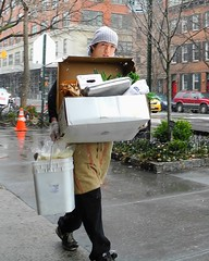 sushi chef in the snow (omoo) Tags: newyorkcity boy snow japanese day snowy westvillage streetscene snowing sushichef wetsidewalk grenwichvillage japaneseboy siewalk restaurantworker youngnman carryingfoodfrombasementtorestaurant japanesereataurant sushichefinthesnow