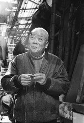 An old watchmaker 1 (Jie Wang SH) Tags: china leica old man film zeiss shanghai chinese watchmaker ilfordhp5400 summicron502 zeissikonzm