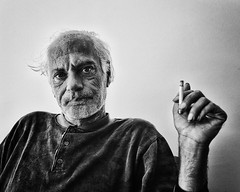 Cigarette smoker (big andrei) Tags: leica portrait bw man look cigarette grain smoker m82 28mm28 elmaritm