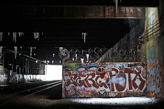 Snowfall (Jon Chevier) Tags: nyc newyorkcity railroad winter light sunlight snow reflection ice colors contrast dark graffiti frozen am high rust gate rocks track shadows darkness manhattan homeless cement skylight trains row highlights symmetry dirt rails ambient pillars rule icicles vents lightrays thirds rafters darkdays rightofway highspeedtrains supportbeams supportcolumn trainbed
