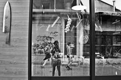 () Tags: street city light people urban blackandwhite bw reflection window monochrome self walking mirror cityscape knife greece daytime ioannina