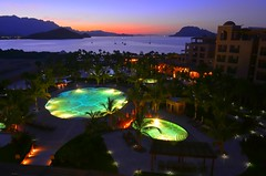 Time to start the evening (Kirt Edblom) Tags: loreto mexico loretomexico 2016 june vacation bcs baja bajacaliforniasur danzantebay danzante gulfofcalifornia islandsofloreto landscape outdoor outdoors water waterscape pool aroundthepool lights resort spa seaofcortez bay bajacalifornia scenic sunset summer villadelpalmar vdp wife gaylene mountains milf easyhdr hdr nikon nikond7100 nikkor18140mmf3556 kirt edblom kirtedblom dusk blue bluesky longexposure green red coast coastline shoreline shore
