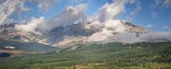 Mountain and Clouds Panorama-Web (hunter20ga) Tags: panorama nikond4 tamron150600 glaciernationalpark earlymorninglight clouds water mountains