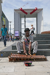 He played lovely music on this instrument (Monceau) Tags: ladfense musician keyboard instrument streetmusician grandearche