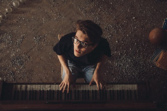 Danny Boy (elijahshadrin) Tags: music retro guy piano grain dark installation russia people photoshop school abandoned canon portrait youth young handsome glasses emotion face elijahshadrin fromabove friends