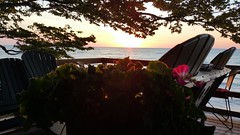 Water in Focus - Sunset back patio - Summer Evening (Smith6612) Tags: evening deep summer sunset orange calm beach water lake erie freshwater deck flowers