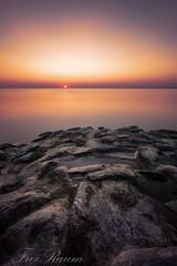 Stille (klausi1983) Tags: sun sunset water ocean location stone relax skyclouds light yellow blue sunrise