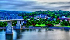 Light breaking on an early Summer morning at Coolidge Park (Roland 22) Tags: lights peaceful daybreak white gray clouds tennesseeriver walnutstreetbridge red blue dawn daylight green bluffviewartdistrict coolidgepark flickr