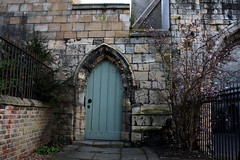 At the foot of St Olaves (Sarah Ross photography) Tags: york sarahr89 sarahrossphotography door doors spring winter flowers stone archway