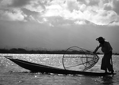 Fisherman of Inle Lake, Myanmar (trickyd3) Tags: blackandwhite lake fishing fisherman asia burma myanmar inlelake fishingboat fishingnet platinumheartaward thebestofday gnneniyisi ruby5 rememberthatmomentlevel1 rememberthatmomentlevel2 netsoutheast