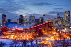 Skyline after fresh snow (John in Calgary) Tags: city blue trees winter red wild sky urban white snow canada calgary skyline clouds skyscraper saddledome alberta calgaryflames jpandersenimages