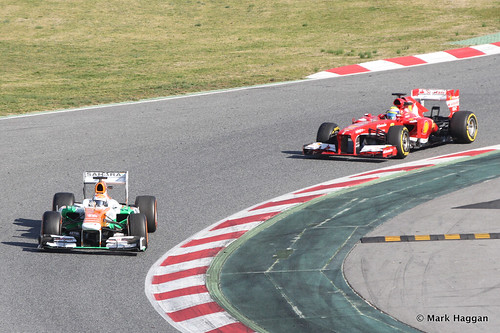 Adrian Sutil in his Force India and Felipe Massa in his Ferrari at Formula One Winter Testing, March 2013