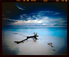 Leftover (tsiklonaut) Tags: ocean travel blue sky white motion 120 film beach water analog indonesia island still sand asia long exposure fuji pentax drum indian wave scan velvia filter shore lee experience tropical tropic roll fujifilm medium format analogue 6x7 southeast 50 gili 3000  motionless  67 pulau kami nusa cpl discover rvp trawangan    it8 drumscan tenggara  gnd  heliopan  nocurnal  photomultipliertube  scanview scanmate shpmc slx2001
