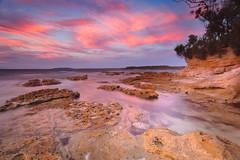 Murrays Beach (stevoarnold) Tags: blue sunset red sea sun seascape color colour beach water beauty rock clouds sunrise sand australia nsw jervisbay