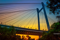 View of  2nd Hoogly Bridge (Mousam Samanta) Tags: bridge sunset india rain river nikon gallery dof cloudy outdoor ngc award indoor bluesky strip nikkor reflexions kolkata bengal 1855mmf3556g westbengal 50mmf18 indoorphotography nikon1855mm abigfave 50mmf18g d5100 nikoneyes nikon1855mmf3556gafsvrdxnikkor super~six nikond5100 nikonafs50mmf18g mousamsamanta