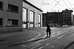 crossing the tracks (gato-gato-gato) Tags: street leica bw white black blanco monochrome digital 35mm person schweiz switzerland abend flickr noir suisse strasse zurich negro hard streetphotography pedestrian rangefinder human monochrom zrich svizzera sonne weiss zuerich blanc manualfocus schwarz freitag onthestreets passant m9 zri mensch sviss  fruehling feierabend langstrasse zwitserland maerz isvire zurigo werd kreis4 fussgnger manualmode zueri aussersihl strase   kreischeib messsucher leicasummiluxm35mmf14asph manuellerfokus gatogatogato fusgnger leicam9 leicasummiluxm35mmf14 gatogatogatoch wwwgatogatogatoch