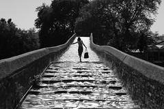 Humans harmed during the construction of this bridge (Elios.k) Tags: bridge summer vacation blackandwhite travelling girl horizontal stone bag walking outdoors walk top perspective tourist greece purse slip balance slippery arta slipping gefyri monom