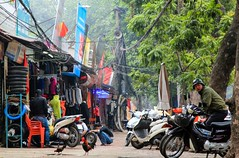 An Easter Vibe on the Streets of Hanoi, Vietnam (Maria_Globetrotter) Tags: life street city travel trees people signs chicken tourism sign canon easter happy december day cloudy action capital scene vietnam motorcycle oster
