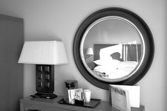 Reflection (EnthusiasticSojourn) Tags: light shadow blackandwhite bw sunlight reflection beach monochrome circle hotel mirror nikon shadows artistic perspective nikkor 1835mm