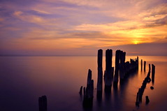 Lake Michigan Sunrise (Seth Oliver Photographic Art) Tags: chicago clouds reflections landscapes iso200 illinois nikon midwest silhouettes lakemichigan pilings sunrises evanston pinoy chicagoland longexposures chicagoist d90 10secondexposure wetreflections nd110filter manualmodeexposure setholiver1 aperturef220 daytimelongexposures 18105mmnikkorlens tripodmountedshot timedelaytriggeredshot bigstopperfilter