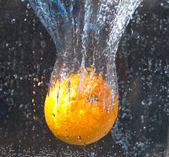 Water splash 1 (Chris Wood 1954) Tags: orange water fruit arty splash artyfarty fasrshutterspeed