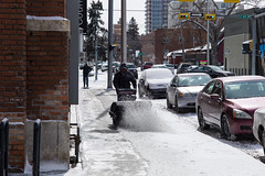 Blows Snow, Snow Blows (christait) Tags: street snow canada man calgary homeless clean alberta recycling sidewalks snowblower bottlepicker leicam9 minolta90mmf4rokkorm