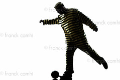 man prisoner criminal playing soccer with chain ball (Franck Camhi) Tags: shadow people white playing man male silhouette ball cutout person one 1 justice costume trapped funny escape adult soccer profile humor fulllength humour player chain indoors criminal whitebackground crime thief law studioshot runaway capture sideview convict punishment isolated striped oneperson prisoner captivity burglar caucasian jailbreak oneman escaping ballandchain