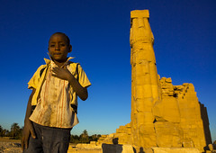 Kid In Front Of The Big Soleb Temple Built By Amenophis Iii, Soleb, Sudan (Eric Lafforgue) Tags: africa old travel sky history archaeology horizontal stone architecture outdoors temple photography kid ancient day child northafrica soedan african sudan sunny bluesky pharaoh column strength ancientcivilization nubia thepast oneperson colonnade ruined traditionalculture soudan deterioration saharadesert northernafrica amenophis collapsing realpeople traveldestinations colorimage famousplace lookingatcamera durability oldruin agingprocess lowangleview childrenonly السودان 1people szudán sudão スーダン northernsudan amuntemple soleb northsudan blackpharaohs σουδάν судан 수단 kingamenhotep סודאן 苏丹蘇丹 xuđan eri1306