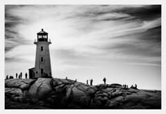 Peggys Coves Lighthouse (fernandobrandaodebraga) Tags: sonya6000 sigmaart canada eastcost landscapephotography blackwhite bw contrast clouds lighthouse rocks people novascotia peggyscove 1yearanniversary vacation roadtrip