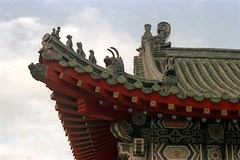 33-217 (ndpa / s. lundeen, archivist) Tags: nick dewolf nickdewolf color photographbynickdewolf 1970s 1972 fall film 35mm winter republicofchina taiwan taiwanese china chinese 1973 building architecture roof rooftop finial figures architecturaldetails swastika swastikas goodlucksymbols 33 reel33