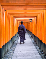 Exploring Kyoto (faraz.azhar) Tags: kyoto japan explore travel destinations tourism temple shrine red culture orange samurai robe path passage walkway passageway pray faith religion man lantern