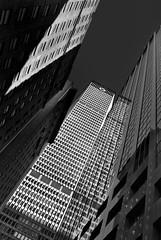 overhang (Rino Alessandrini) Tags: grattacielo imponente alto piani acciaio vetro riflessi finestre geometrie architetture facciate eipetizione urbano geometrico forme ombre luce nyc impressive highrise plans reflections steel windows glass facades urban geometries architectures geometric shapes light shadows