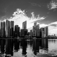 Cloud Flare (syphrix photography) Tags: singapore cityscape city marina bay light black white monochrome landscape syphrix 2016 photography outdoor x100s fujifilm asia south east fuji panorama sunset building financial district cloud formation central cbd tall structure skyline reflection water