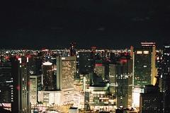 Osaka (moist memory) Tags: film fe2 nikon osaka japan night cityscape light lomo lomography skyscraper