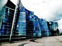 Christchurch Art Gallery (Steve Taylor (Photography)) Tags: street city blue windows newzealand christchurch cloud reflection art glass lines st mirror gallery day cloudy pavement montreal curves nz gloucester paving southisland cbd crescents theinspirationgroup