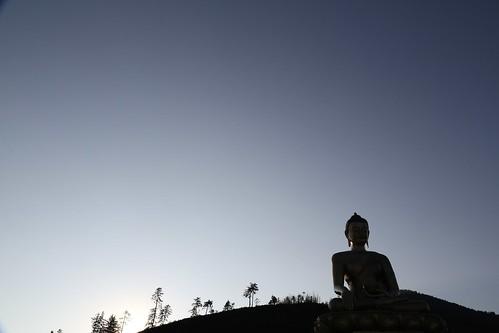 Dark shadows encompass the Buddha Dordenma statue (Bhutan)
