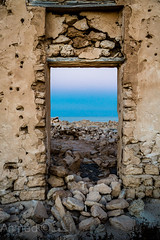 window to the sea (Ahmed ) Tags: door sea sky home window stone canon traditional ahmed qatar
