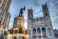 Maisonneuve et Basilica (Dan Chui (on/off!)) Tags: city travel decorations sky urban canada history church glass architecture bronze night clouds buildings geotagged lights evening nikon worship catholic glow cross quebec dusk montreal famous prayer religion gothic towers citylife statues tranquility stainedglass landmark tourists christianity 24mm spirituality ornate metropolitan hdr notredamebasilica vieux d800 placedarmes     maisonneuvemonument