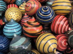 Multicolored Spinning Tops (Batikart) Tags: blue autumn red orange black game green colors lines yellow closeup canon germany circle ceramic toys outdoors deutschland mix focus europa europe colours dof play bright market vibrant stripes patterns painted herbst ring collection round spinning pottery colored leisure ribbon choice practice multicolored markt ursula onsale coloured tops assortment variation mixture circular patience 2012 canonpowershot sander g11 keramik badenwrttemberg swabian kreisel badwimpfen largegroupofobjects mischung 2013 200faves spintops batikart