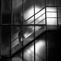 Hellbound (martinfowlie) Tags: cambridge blackandwhite blur glass stairs dark down figure railings cambridgeuniversity hellbound thebreeders