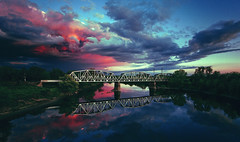 clouds over bridge (Carlos Eliason) Tags: bridge sunset bike clouds zeiss cycling dream biking 5d sacramento epic zeiss18mm
