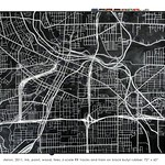 """<b>Rubber City: Akron, 2011</b><br/> (Benincasa, White ink, oil paint, wood, tires, z-scale train and railroad tracks on black butyl rubber)<a href=""""http://farm9.static.flickr.com/8386/8622628032_251e8b179b_o.jpg"""" title=""""High res"""">∝</a>"""