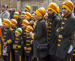 Sikh boys and men watch the 2013 Vaisakhi festival parade in Southampton (Anguskirk) Tags: uk england color colour festival hampshire procession sikh gurdwara southampton turbans saris vaisakhi nagarkirtan