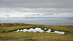 Crescent Pond (claustral) Tags: sea lake mountains water grass landscape coast iceland pond wide d800 nikd