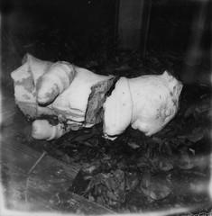 Broken (kayla polaroid photography) Tags: impossiblefilm polaroid analogfilm 600film blackandwhite spooky ghostly haunting bunny statue