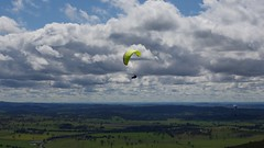 Al climbing out (overflow50) Tags: paragliding paraglider canberra spring springhill sky clouds