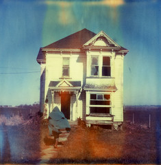 (theonlymagicleftisart) Tags: house abandoned vintage polaroid sx70 flames victorian cloak expired ferndale timezero impossibleproject