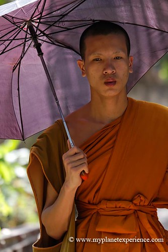 Buddhist monk with an umbrella - Laos